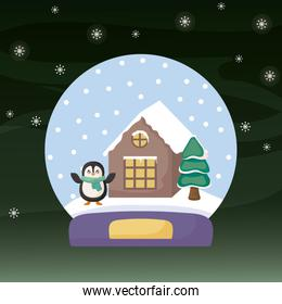 crystal ball with penguin, house and christmas trees