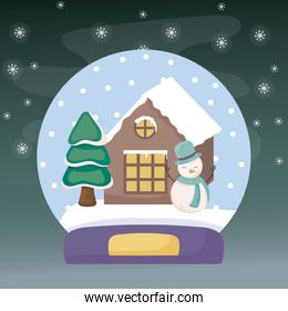 crystal ball with snowman and house on winter landscape