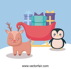 reindeer with sled of gift boxes and penguin christmas