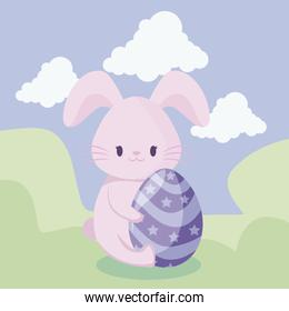 cute rabbit with egg of easter in landscape