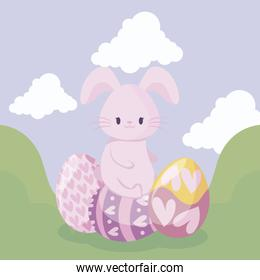 cute rabbit with eggs of easter in landscape