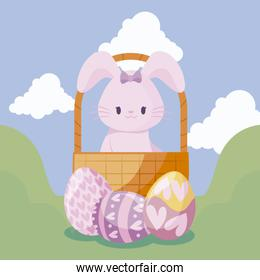 cute rabbit in basket and eggs of easter