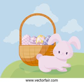 cute rabbit with basket and eggs of easter