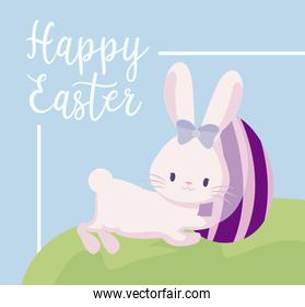 cute rabbit female with egg of easter in landscape