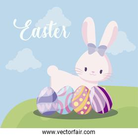 cute rabbit female with eggs of easter in landscape