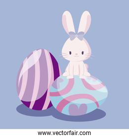 cute rabbit female with eggs of easter