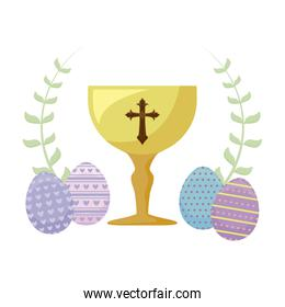 chalice with eggs of easter and flowers