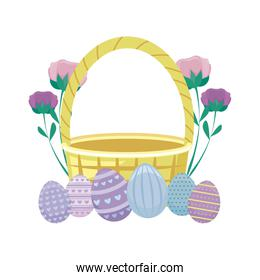 basket wicker with eggs of easter and flowers