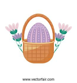 egg of easter in basket wicker with flowers