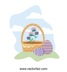 eggs of easter with basket wicker and flowers