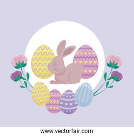 cute rabbit with eggs of easter and flowers