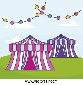 circus tents with garlands in grass