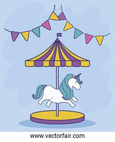carousel with unicorn and garlands hanging