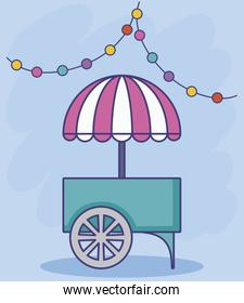 carnival kiosk with umbrella and garlands hanging