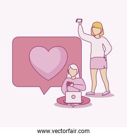 women using laptop and smartphone with speech bubble