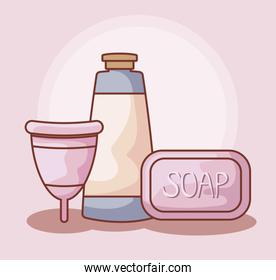 menstrual cup with soap and tube bottle