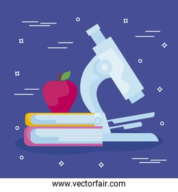 microscope laboratory with books and apple