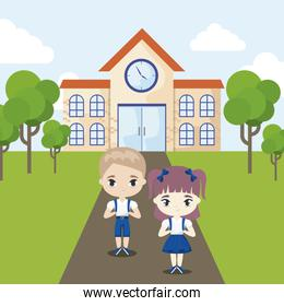 cute little students front of school building