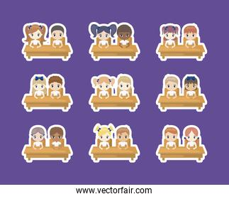 group of cute little students seated in school desks