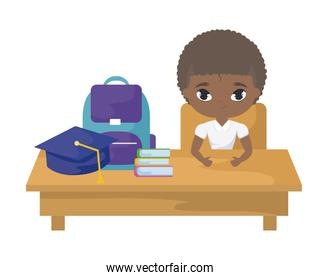student boy afro sitting in school desk with supplies education