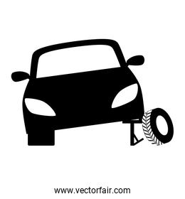 Black tire being placed in the car