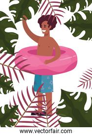 tourist man in swimsuit with float tropic leaves summer
