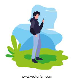man using smartphone in the landscape