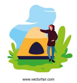man with tent camping hiking