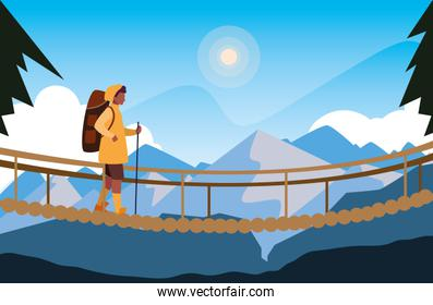man crossing bridge mountains landscape