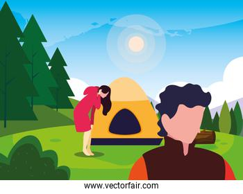 man and woman hiking camp tent forest