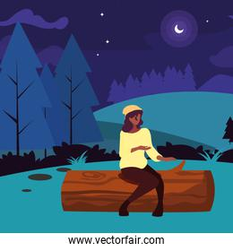 woman sitting trunk field hiking forest