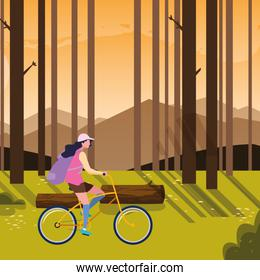 traveler woman with bag riding bicycle