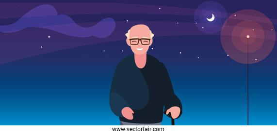 old man with walk stick at night