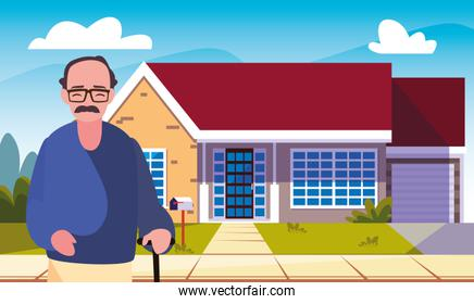 old man standing next house exterior