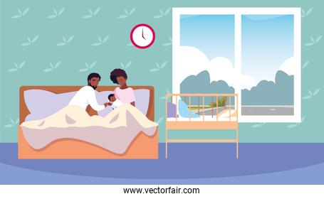 afro mom and dad taking care baby in bed