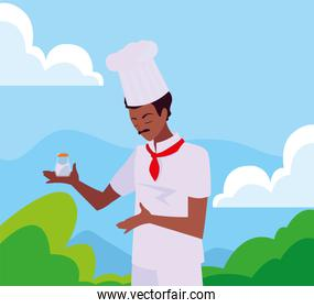 man chef holding frying pan cooking