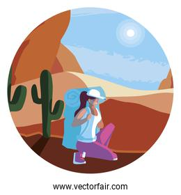 adventurous woman with travelbag in the desert