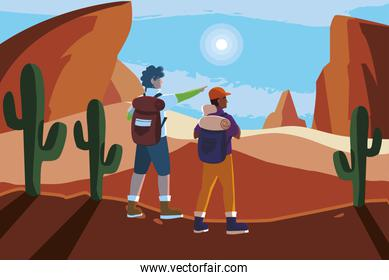 adventurous couple with travelbag in the desert