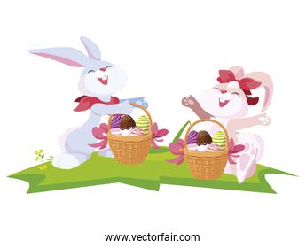 cute rabbits couple with eggs painted in basket