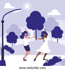 young interracial girls dancing in the park