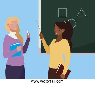 interracial female teachers couple with textbooks and chalkboard