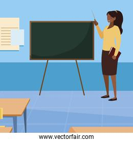 black female teacher with textbook in classroom