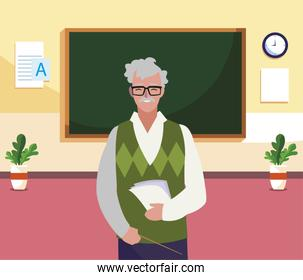 teacher male with documents in the classroom