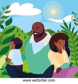 black parents couple with son in the landscape