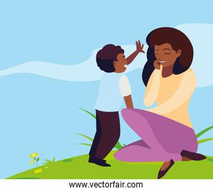 beautiful black mother with son in the field