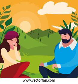 young couple seated in the field