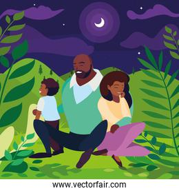 black parents couple with son in the landscape at night
