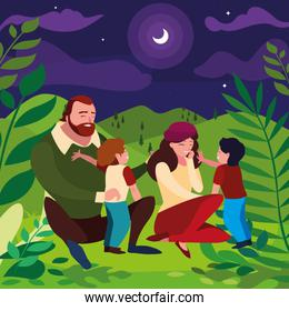 parents couple with sons in the field at night