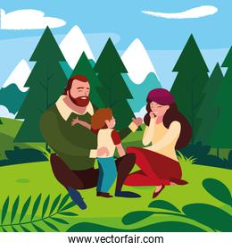 parents couple with son in the field