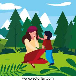 beautiful mother with son in the landscape